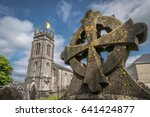 celtic cross on a tomb in a...