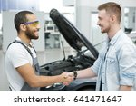 handsome young male car owner... | Shutterstock . vector #641471647