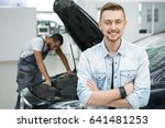 handsome young man smiling to... | Shutterstock . vector #641481253