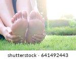 foot pain .woman sitting on... | Shutterstock . vector #641492443