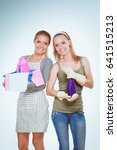 Small photo of Two women is cleaning something with wisp and spray attentively.