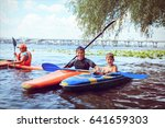 man paddling in kayak is on a... | Shutterstock . vector #641659303