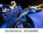 two go cart drivers battling in ... | Shutterstock . vector #64166680