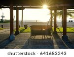 bench on the sandy beach at the ... | Shutterstock . vector #641683243