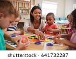 teacher and pupils using flower ... | Shutterstock . vector #641732287