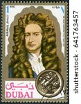 Small photo of MOSCOW, RUSSIA - JUNE 05, 2016: A stamp printed in Dubai shows Sir Isaac Newton (1642-1727), scientist, portraits, circa 1971
