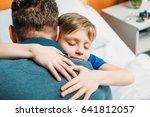 portrait of little son hugging...   Shutterstock . vector #641812057