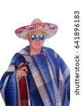 Small photo of A man wears a Mexican Sombrero, a Serape or Poncho sunglasses and smokes a big cigar as he celebrate a Mexican holiday or tradition. Isolated on white, Room for text.