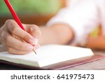 closeup of woman's hand writing ... | Shutterstock . vector #641975473