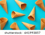 Small photo of Ice cream cones pattern. Turquoise background. Sweet, summer and empty concept. Top view. Flat lay