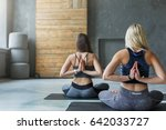 women in yoga class making