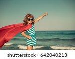 superhero child on the beach....   Shutterstock . vector #642040213