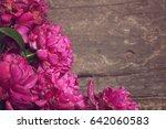 pink peonies on wooden... | Shutterstock . vector #642060583