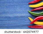 cayenne chilli peppers on blue...   Shutterstock . vector #642074977
