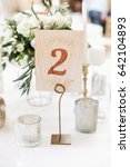 Small photo of Number on a table in restaurant. Festive banquet.
