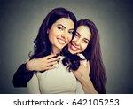 best friends two women hugging... | Shutterstock . vector #642105253