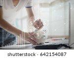 hands of men put coin in the... | Shutterstock . vector #642154087