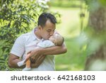 Portrait Of Happy Father With...