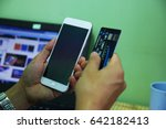 hands holding credit card and a ... | Shutterstock . vector #642182413