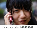 young japanese woman  phone... | Shutterstock . vector #642395947