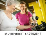 personal trainer working... | Shutterstock . vector #642402847