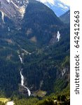 Small photo of Krimml Waterfalls on Gerlos Pass, Austrian Alps, Austria. Krimmler is a tiered waterfall. The upper stage has a drop of 140 metres, the middle of 100 metres, and the lowest a drop of 140 metres.