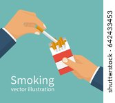 cigarettes in hand man. smoker... | Shutterstock .eps vector #642433453