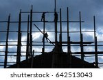 silhouette of men working on a... | Shutterstock . vector #642513043