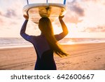 surf girl with long hair go to... | Shutterstock . vector #642600667
