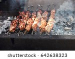 raw kebab grilling on metal... | Shutterstock . vector #642638323