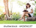 beautiful woman reading a book... | Shutterstock . vector #642656137