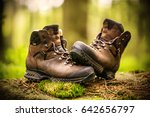 a pair of brown hiking boots. | Shutterstock . vector #642656797