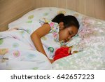 Small photo of a girl patient admit in hospital, admit patient sleeping on the bed and dream of beautiful flowers