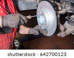 assembler mounts new brake disc ... | Shutterstock . vector #642700123