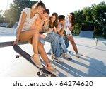 Teens Relaxing In Skate Park