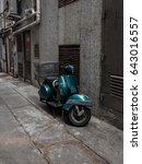 Small photo of A dark metalic green Vespa parked in an alleyway. Off Lockhart rd, Causeway Bay, Hong Kong Island. Dated 9th May 2017.
