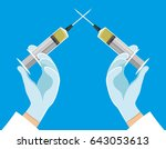 crossed syringes in hands. | Shutterstock .eps vector #643053613