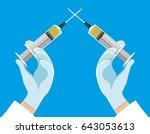 crossed syringes in hands. | Shutterstock .eps vector #643053613