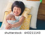 little sister hugging and... | Shutterstock . vector #643211143