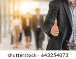 businessman giving thumb up as... | Shutterstock . vector #643254073