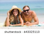 portrait of happy couple lying... | Shutterstock . vector #643325113