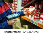 warehouse worker scanning... | Shutterstock . vector #643364893