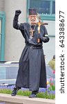 Small photo of Unidentified Street Preacher in Chicago was in the median on Michigan Ave waving to the crowds and the people driving by. This was on May 5th, 2017.