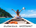 Small photo of Happy woman traveler in bikini relaxing on boat her arms open feeling freedom, Andaman sea, Surin island, Phangnga,Travel in Thailand, Beautiful destination Asia, Summer holiday outdoors vacation trip