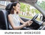 girl drives a car   Shutterstock . vector #643614103
