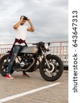 handsome rider guy with beard... | Shutterstock . vector #643647313