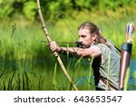 Archer Man Shooting The Bow An...