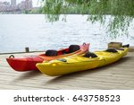 two kayak boats on wooden deck... | Shutterstock . vector #643758523