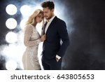 elegant celeb couple posing on... | Shutterstock . vector #643805653