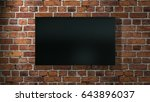 big flat screen tv hanging on... | Shutterstock . vector #643896037
